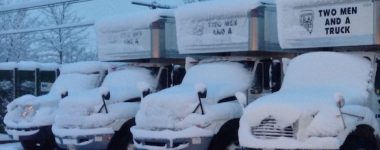 Trucks covered in snow